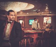 Man in luxury casino interior Royalty Free Stock Photography