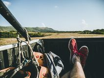 The man lying in the back of the truck. First person view of the man lying in the back of the truck Royalty Free Stock Images