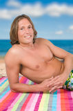 Man lying on the beach. Handsome man lying on the beach Stock Photo