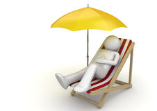 Man lying on a beach chair ynder umbrella Stock Photo
