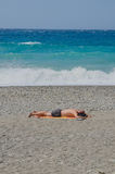 Man lying in the beach Royalty Free Stock Photo