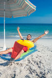 Man lying on the beach with flippers and rubber ring Stock Photography