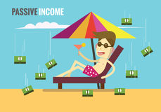 Man is lying on the beach while the money are rolling down from Royalty Free Stock Image