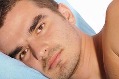 Man lying on the bed Royalty Free Stock Photography
