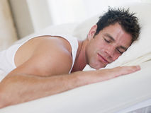 Man lying in bed Stock Photos