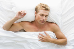 Man lying in bed Royalty Free Stock Photos