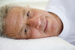 Man lying in bed Royalty Free Stock Photo