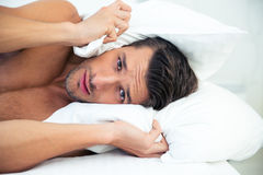 Man lying on the bed Stock Photo
