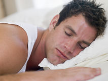 Man lying in bed sleeping Royalty Free Stock Photo