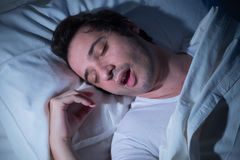 Man lying bed Stock Photo