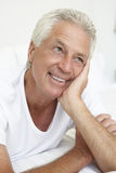 Man lying in bed smiling Royalty Free Stock Photo