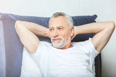Man lying in bed royalty free stock images