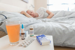 Man is lying in bed to recover from flu Stock Photography