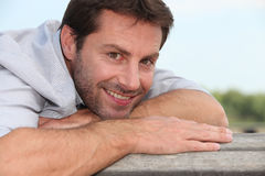 Man lying on bench Stock Photography