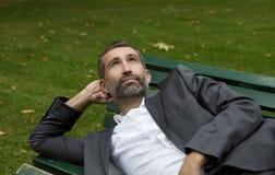 Man lying on bench Royalty Free Stock Image