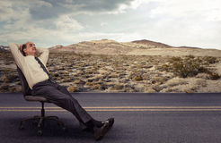 Man is lying on a chair outdoors daydreaming. Office worker man is lying on a chair outdoors daydreaming Stock Images