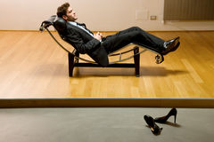 Man lying on chaise longue Royalty Free Stock Photo