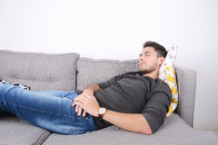 Man lying on couch. Royalty Free Stock Photography