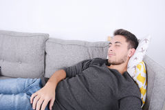 Man lying on couch. Stock Image