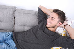 Man lying on couch. Stock Photography