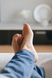 Man lying on the couch Stock Photo
