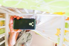 smartphone addition and parenthood royalty free stock photography