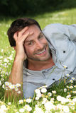 Man lying among the daisies Royalty Free Stock Photography