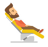 Man lying in dentist chair Stock Photography