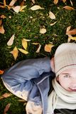 Man lying down. Man with hands over his head lying in the fall Stock Image