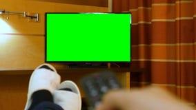 Man lying down bed relaxing bed watching green screen TV. Man lying down bed relaxing on the bed watching green screen TV stock video