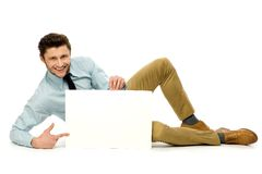 Man lying down with blank poster Royalty Free Stock Photo