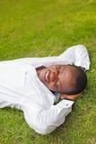 Man lying down on a grass Stock Photo