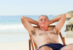 Man lying down in his deck chair Royalty Free Stock Images