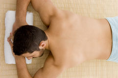 Man lying down for spa treatment Royalty Free Stock Photography