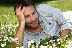 Man lying in a field Royalty Free Stock Photo