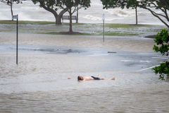 Man lying in floodwaters Royalty Free Stock Photography