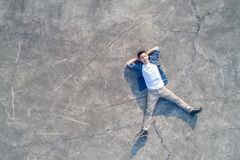 Man lying on floor Stock Photography