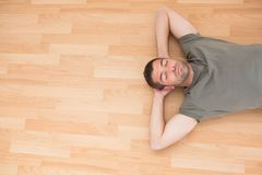 A man lying on floor at home Royalty Free Stock Images