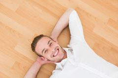 A man lying on floor at home Royalty Free Stock Image