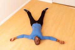 Man lying floor Stock Images