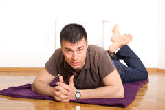 Man lying on the floor on stomach Stock Images