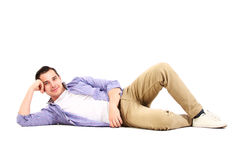 Man lying on floor Stock Photos