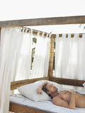 Man Lying In Four Poster Bed Royalty Free Stock Image