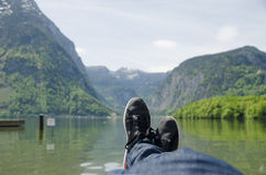 Man lying in front of a lake. Royalty Free Stock Image