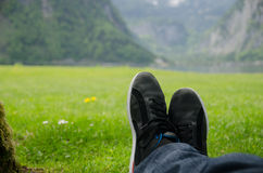 Man lying in front of a lake. Stock Photos