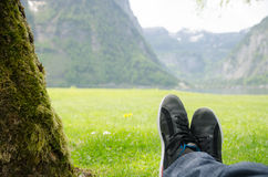 Man lying in front of a lake. Royalty Free Stock Photos