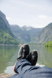 Man lying in front of a lake. Stock Photo