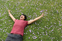 Man lying on the grass Stock Images