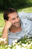 Man lying on grass Royalty Free Stock Photography