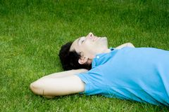 Man lying on the grass Stock Image